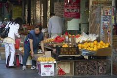Fruit shop. (gunnar.berenmark) Tags: street city nyc usa newyork shop fruit work chinatown market manhattan stad shopkeeper entrepreneur grandstreet