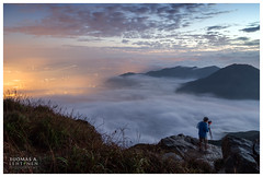 Above the clouds (Tuomas A. Lehtinen Photography) Tags: china above morning sky mountain nature horizontal fog clouds canon landscape outdoors island person eos dawn lights high asia photographer view dusk hiking hill scenic peak hong kong lantau 6d 24105mm