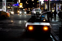 Took this pic last night in Manhattan... who says time machines do not exist? (Alex Szymanek) Tags: street city nyc travel urban ny newyork color cars colors look car night canon reflections lights see focus nightlights time pavement manhattan silhouettes center midtown future hood 5d parked timetravel moment capture past delorean chill 70200 dmc urbanite markiii