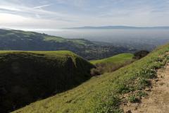Coming around (LeftCoastKenny) Tags: trees grass clouds rocks hills sierravistatrail sierravistaopenspacepreserve