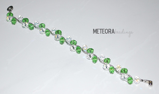 Bracelet - green and clear beads with silver spacers