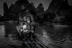 Done and ready to go... (Syahrel Azha Hashim) Tags: china travel light sunset vacation portrait holiday mountains detail bird hat birds clouds river cormorants beard dawn fishing fisherman nikon dof guilin getaway unique traditional chinese naturallight oldman bamboo tokina elite portraiture elder handheld local lantern shallow moment dramaticsky iconic 11mm conventional humaninterest bambooraft uwa xingping ultrawideangle d300s syahrel