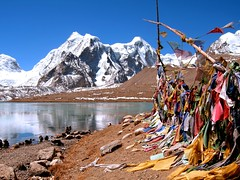 Gurudongmar Lake.....  A Place of Peace and Tranquility (pallab seth) Tags: travel sky india mountain lake snow cold tourism digital landscape religious nikon asia tour place wind flag peak buddhism tibet coolpix prayerflags hinduism sikkim prayerflag p3 northsikkim nikoncoolpixp3 nikonp3 prayingflags tibetianplateau gurudongmar indianlandscapephotography highestfreshwaterlakes