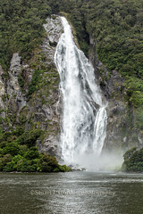 Waterfall, Milford Sound, New Zealand II (chasingthelight10) Tags: travel newzealand storm mountains nature rain sunrise photography landscapes countryside waterfall seascapes events places things milfordsound fjords stormclouds mitrepeak