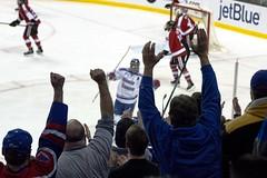 UMass Lowell fans cheer the tying goal (Odie M) Tags: hockey sport boston happy championship nu skating icehockey huskies celebration finals fist fans cheer ncaa riverhawks northeastern uml northeasternuniversity collegehockey hockeyeast 2016 teamsport umasslowell tdgarden