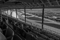 High In The Grandstands (Atlanta Motor Speedway) (♡✌ Kᵉⁿ Lᵃⁿᵉ ✌♡) Tags: atlanta blackandwhite bw usa monochrome grass metal architecture racetrack fence georgia geotagged blackwhite cool chair pattern shadows unitedstates outdoor seat awesome columns seats nascar column autoracing bleachers hampton pillars blacknwhite ams bnw infield ibeams finishline colonnade grandstand sunnyday handrails startline baw monochromeblackandwhite blackwhitephoto startfinishline atlantamotorspeedway grandstands automobileracing smi speedwaymotorsportsinc hamptongeorgia nascarsprintcupseries nationalassociationforstockcarautoracing hamptonga catchfence foldupseats nascarracetrack february2016 foldsofhonorquiktrip500 geo:lat=3338678445 geo:lon=8431929453 cloverranchmobilehomepark