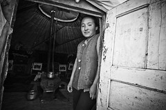 Mongolian hospitality (NeSlaB .) Tags: travel blackandwhite girl look canon photo blackwhite asia village desert traditional country culture photojournalism s clothes mongolia tradition ethnic developingcountries reportage nationalgeographic ethnography ethnology ethnies neslab