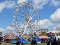 Strates Shows Gondola Wheel. (dccradio) Tags: sky tractor sc wheel festival clouds fun myrtlebeach ride southcarolina bluesky fair entertainment ag ferriswheel agriculture tractors countyfair amusements agricultural farmequipment carnivalride thrillride farmmachinery amusementride communityevent newholland myrtlebeachspeedway fairride horrycounty mechanicalride gondolawheel technicalpark amusementdevice horrycountyfair altmantractorofconway