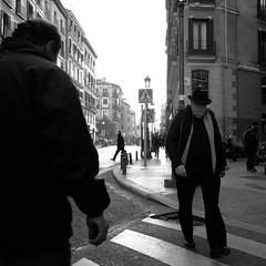 Three men (DSCF5170) (Denkrahm) Tags: madrid street light hat scarf denkrahm lookdown pedestrians threemen pedestriancrossingsign fujifilmx70