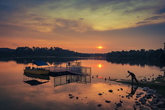 Sunset Fishing (elenaleong) Tags: sunset clouds fishing rainforest singapore silhouettes reservoirpark lowerpeircereservoir reflectionsofthesun