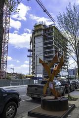 Art piece and cranes Milwaukee Ave. pic26 4-25-2016 (Artemortifica) Tags: street bridge sky chicago cars clouds buildings construction blueline crane bikes graffity milwaukee western trucks damen