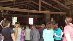 Local Iowa students getting a lesson about the role of the town's blacksmith