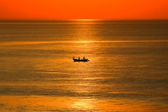 Lonely fisherman's boat in a golden sea (Lior. L) Tags: sunset sea beach silhouette golden boat brilliant fishermansboat