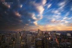 Concrete jungle (markkatzphotography) Tags: nyc newyorkcity sunset sky usa newyork skyline clouds canon cityscape skyscrapers manhattan worldtradecenter gotham metropolitan goldenhour eastcoast urbanlandscape cityviews movingclouds nicesky beautifulsunsets nicelighting oneworldtrade markkatzphotography