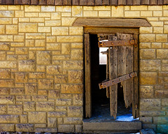 Door's Seen Better Days (Jae at Wits End) Tags: door old abstract building brick texture abandoned broken lines metal wall architecture outside rust pattern exterior outdoor decay bricks rustic neglected entrance rusty structure pale line wear doorway faded forgotten worn oxidation weathered opening portal bent discarded forsaken damaged shape rejected broke corrosion cracked entry decayed bleached brickwork faint patina corroded oxidized discolored