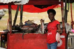 Street vendor, Boca Chica (dariusz werhun) Tags: street red fish dominicanrepublic vendor blackwoman bocachica