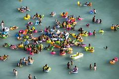 Anthropology in Waikiki (Guy: Jussum Guy) Tags: ocean people men beach kids hawaii women colorful waikiki oahu honolulu flotation pentaxk3