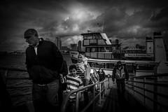 arriving (efrainsalvadorjr) Tags: blackandwhite ferry zeiss sandiego streetphoto coronado sandiegoskyline carlzeiss biogon streetpics sandiegoharbor streetphotographers sonyalpha a7r biogon28mm blackandwhitepics mflens sandiegoferry adaptedlenses sonya7r