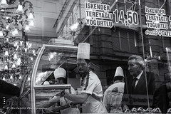 Street 74 (`ARroWCoLT) Tags: street people bw food man reflection glass photography blackwhite candid fastfood cook fast samsung mini istanbul f18 dner showcase kebab seller beyoglu istiklal doner sokak kokorec nx 17mm siyahbeyaz kokore nxm