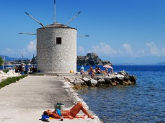 hot summer times (mujepa) Tags: sea mer windmill vacances holidays greece corfu grce sunbathing corfou bronzing
