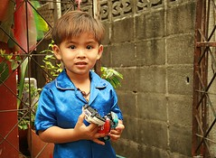 handsome boy in his blue silk pajamas (the foreign photographer - ฝรั่งถ่) Tags: blue boy cars portraits canon toy thailand kiss bangkok silk handsome pajamas khlong bangkhen thanon 400d