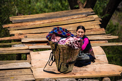 Manaslu round, Nepal. (David Ducoin) Tags: nepal woman baby girl trekking children asia child np babysitting himalaya porter carry carrying manaslu gorkha