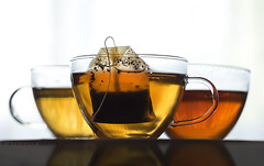tea for 2 ...or 3 (marianna armata) Tags: food orange macro cup water glass leaves yellow bag gold leaf healthy tea drink fresh clear infusion pouch translucent hmm liquid herb marianna armata macromondays