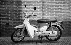 Immaculate Super Cub Copy (Arne Kuilman) Tags: classic film netherlands amsterdam rollei honda japanese nederland mint scan xp2 pointandshoot copy ilford 50cc riders supercub madeinjapan hondasupercub brommer klassieker giro90