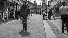 Bangor Streets (Howie Mudge LRPS) Tags: road street uk travel windows light portrait people urban blackandwhite bw woman man men travelling monochrome wales architecture buildings outside outdoors person photography mono blackwhite women eyecontact day doors shadows bright pavement path candid cymru bangor streetphotography sunny streetlife panasonic shade shops casual pathway csc towncenter urbanphotography mft shootintothesun mirrorless micro43 microfourthirds mirrorlesscamera compactsystemcamera lumixgvario1442f3556ii micro43mountlenses panasonicdmcgx8 169perspective