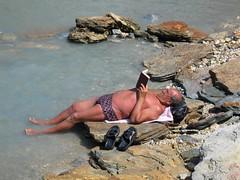 Burning man (chipje) Tags: sea italy man beach island sunburn sicily tanning vulcano