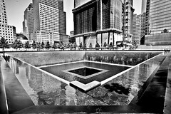 New World Trade Center. Memorial. NY, summer 2013. (Emanuele Barcali) Tags: plaza city shadow vacation bw usa ny newyork black building bus statue museum brooklyn night skyscraper river liberty grey monocromo us newjersey memorial jerseycity day state withe centralpark harlem manhattan library taxi worldtradecenter broadway newyorkpubliclibrary 5thavenue timessquare brooklynbridge figure eastriver jersey guggenheim hudson marines chrysler fifthavenue rockefeller met avenue apollo 5th bigapple metropolitan metropolitanmuseum ellisisland publiclibrary guggenheimmuseum thebigapple blackwithe apollotheater libertystatue metropoli newworldtradecenter neverforgotten avenuegrand oneworldtradecenter centerrockefellerempire buildingempirechrysler evenuelexington centralgrandcentralterminal buildingchryslerstationrailwaypark