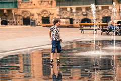 Plish plash.... (zilverbat.) Tags: city boy portrait people urban playing photography scenery dof child image bokeh citylife streetphotography dramatic streetlife streetscene malta bookcover innercity cinematic portret valletta streetshot urbanlife fountin candidphotography fontijn streetcandid peopleinthecity straatfotografie zilverbat