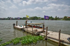 Pier on Ko Kret, an island in the Chao Phraya river near Bangkok, Thailand (UweBKK ( 77 on )) Tags: water river thailand flow island pier boat asia bangkok sony flags ko southeast alpha dslr chao koh 77 slt pak kret phraya kokret kohkret pakkret