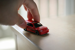 Just Don't Want To Grow Up (Kenny Dong) Tags: light red playing hot classic cars field car canon honda table toy toys hands play hand bokeh top finger fingers wheels indoor hotwheels civic depth