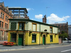 Peveril of the Peak, public house, Manchester, Lancashire (rossendale2016) Tags: old city flowers chimney food plants house window public beer up modern bar manchester high pub skyscrapers centre traditional peak games guinness upper alcohol baskets hanging ornate rise surrounded wilsons fashioned peveril bricked hostelry