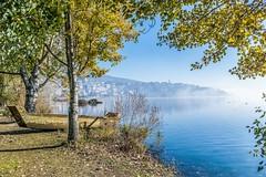 Lake Kastoria (theo.mirk) Tags: sky mountain lake bird landscape boat outdoor samsung greece macedonia mountainside timeless macedonian kastoria makedonia         nx300