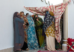 women looking a wedding ceremony, Hormozgan, Bandar-e Kong, Iran (Eric Lafforgue) Tags: wedding people horizontal outdoors togetherness clothing women asia iran muslim islam traditional curtain ceremony culture traditions marriage persia folklore womenonly east kong celebration entertainment arab textiles cheerful custom eastern groupofpeople cultures adultsonly cultural islamic ethnicity middleeastern persiangulf traditionalculture sunni traditionalclothing hormozgan إيران bandari fulllenght иран 5people イラン irão straitofhormuz 伊朗 colourpicture bandarekong 이란 irandsc05286