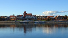 Toru reflecting in Wisa (JoannaRB2009) Tags: old city blue summer sky church water architecture buildings reflections landscape cityscape view towers churches poland polska unesco historical thorn wisa vistula waterscape toru