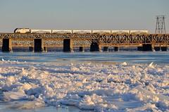 Ice along the river's edge (Michael Berry Railfan) Tags: bridge ice quebec montreal lasalle stlawrenceriver commutertrain amt passengertrain emd gmd f59phi agencemtropolitainedetransport amt1325