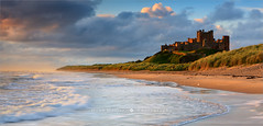 Bamburgh Castle - Northumberland - England (~ Floydian ~ ) Tags: greatbritain morning england seascape castle beach nature water sunrise canon landscape photography dawn coast bravo waves unitedkingdom northumberland northsea coastline bamburgh atlanticocean floydian canoneos1dsmarkiii henkmeijer