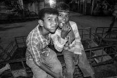 H504_3132-3 (bandashing) Tags: street friends england bw boys monochrome night work children manchester friendship eat labour nightlife nut cart sylhet bangladesh socialdocumentary childlabour paan betel mouthful aoa supari bandashing akhtarowaisahmed