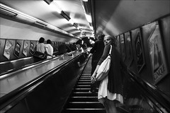 from time to time there is a face in the anonymous crowd (lunaryuna) Tags: city people urban bw london monochrome underground blackwhite candid crowd streetphotography commute lunaryuna commuters anonymity moloch agaze molochsbelly homourbe