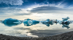 Jokulsarlon glacier lagoon (DigitalAutomotive) Tags: ocean travel blue sunset sea vacation sky cloud mountain cold ice water beautiful yellow clouds landscape photography frozen iceland nikon long exposure outdoor lagoon panoramic september glacier photomerge serene nordic wilderness northern visitor cloudformation jokulsarlon d7100