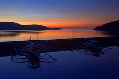 Linapacan Sunrise II (PacificKlaus) Tags: blue orange reflection sunrise landscape harbor boat philippines coron hdr highdynamicrange elnido banka palawan linapacan submarinerdiving