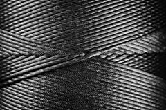 CrissCrossed (Matt GNH) Tags: black detail macro closeup dark tie sew textile repair string strong material bobbin twisted reel spool