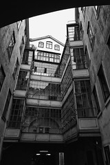 Inner courtyard, a spot of light (Oliver_D) Tags: vienna wien sky bw monochrome architecture himmel stadt architektur altstadt oldtown oldbuilding schwarzweis