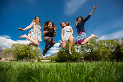 Leaping for spring. (Flickr_Rick) Tags: woman girl sarah outside casey spring jump jumping roommates erin bluesky skirt greengrass jumpology