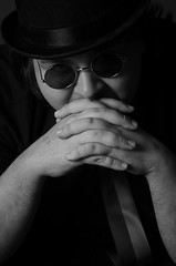 Untitled (patrycjamarciniak) Tags: portrait blackandwhite monochrome hat glasses bowlerhat elegant derbyhat lennons lennonglasses