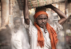 The Porter (Explored ) (georgerani532) Tags: portrait india basket market naturallight mumbai porter stealingshadows orangeheadscarf canon70d