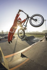 Superman Santa (Marin Lončar) Tags: winter sun bike canon jump bmx extreme osijek croatia sunny superman fisheye skatepark t3i 2015 600d pannonian supermansanta rokinon8mm